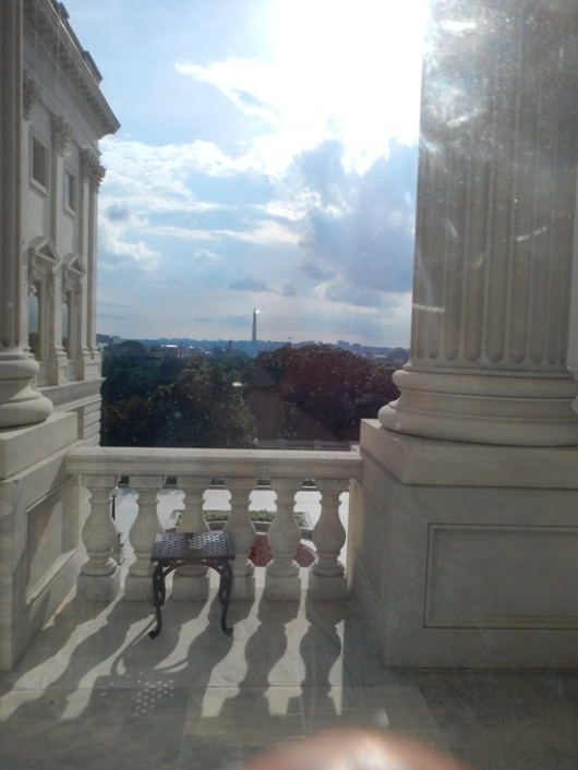 Washington Monument through Capitol window